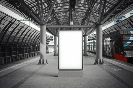 Blank white banner at metro station with arrived train on a background Banco de Imagens