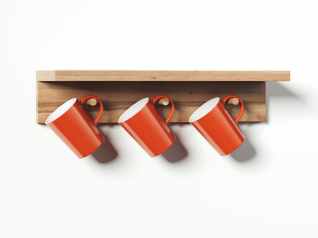 Set of red mugs hanged on wooden cup hanger. 3d rendering. 写真素材