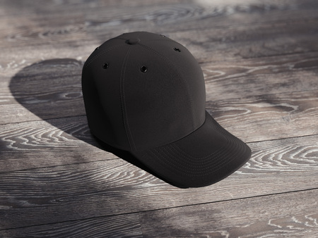 Black realistic cap isolated on wooden background, 3d rendering