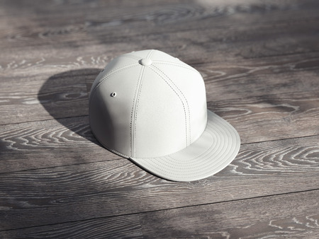 White cap isolated on wooden background, 3d rendering