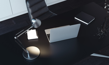 Close up of laptop, lamp and notepad on the table, 3d rendering.