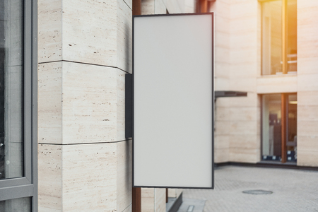 Blank store signboard. Empty shop lightbox on the wall. 3d rendering.