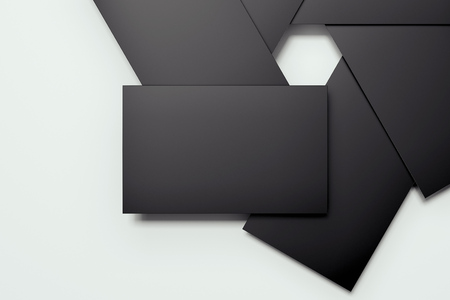 Blank black cards arranged in camera diaphragm shape, 3d rendering. Фото со стока