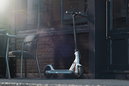 Electric scooter on cityscape background. eco transport concept. 3d rendering 스톡 콘텐츠 - 117814354