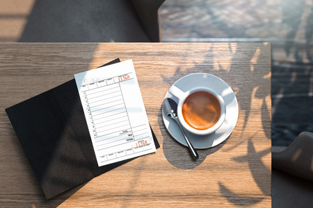 Cheque and coffee cup on wooden table in modern bright cafe. 3d rendering.