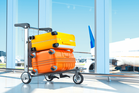 Two modern coloured blank suitcases with airport on background, 3d rendering.