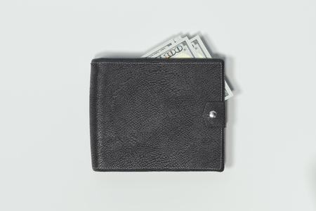 Close up of wallet with cash money isolated on white background. 3d rendering. 免版税图像