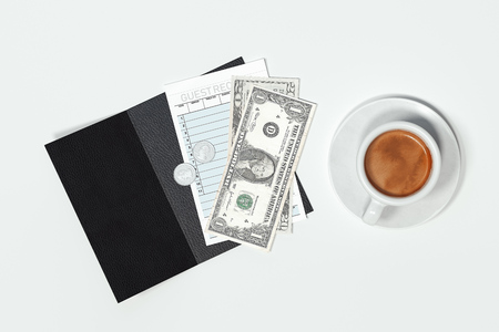 Cheque, cash money and coffee cup isolated on white background. 3d rendering. Stock Photo