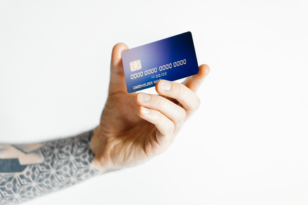 Man hand holding bank card isolated on white background. 3d rendering.