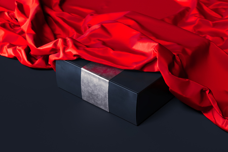 Close up of black blank box under red cloth on black background. 3d rendering.
