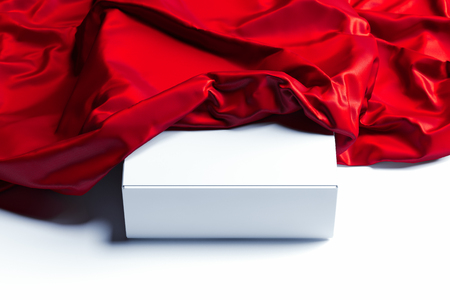 Close up of white blank box under red cloth on white background. 3d rendering. Stock Photo