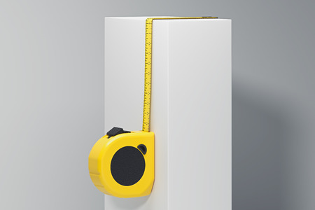 Close up of realistic yellow measure ruler on white cube on bright background. 3d rendering,