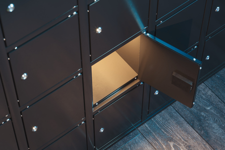 Safe deposit boxes with switched-on light. Safety closets. 3d rendering