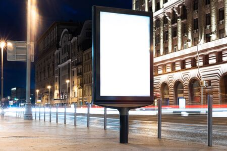 Blank white outdoor banner stand at night time in the city 스톡 콘텐츠