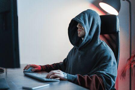 Hacker working on PC. Modern working place of designer, painter, freelancer.