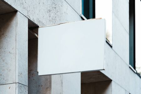 Blank store signboard mockup. Empty shop signage template mounted on the wall. Street sign, 3d rendering.