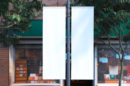 Blank white roll up mockup at street. Empty poster template. Street sign, signage, 3d rendering.