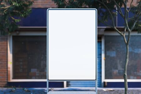 Blank illuminated white outdoor banner stand at day time in the city, 3d rendering. Front view.