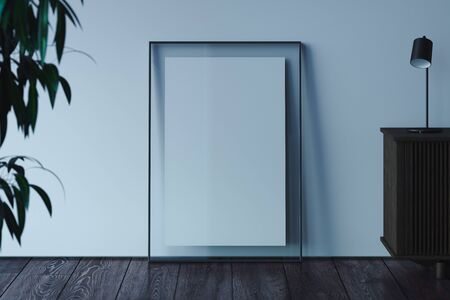 Blank transparent photo frame with blank poster on wooden floor next to light walls, 3d rendering. Banco de Imagens