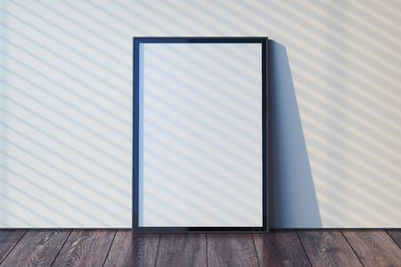 Blank photo frame with blank poster on wooden floor next to light walls, 3d rendering