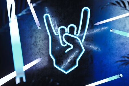 Hand in rock and roll sign made from neon lamps on dark background. 3d rendering.