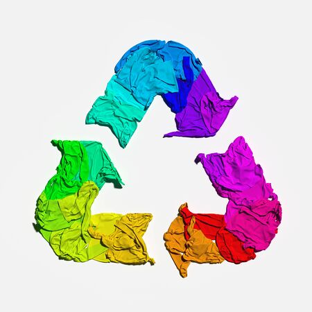 Multicolored recycling sign made from cloth on white background. Eco environment protection concept. 3d rendering.