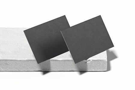 Close up of black blank business cards set on concrete showcase. 3d rendering. Empty space. Copy space.