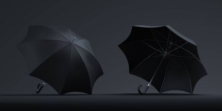 Realistic black umbrellas isolated on dark background. 3d rendering. Copy space. Empty space Stockfoto