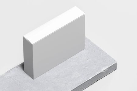 Close up of white blank cardboard box on concrete pedestal, showcase. 3d rendering. Empty space. Copy space.