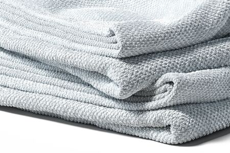 Gray soft towels isolated on white background. Concept of soft and delicate fabrics. 3d rendering.