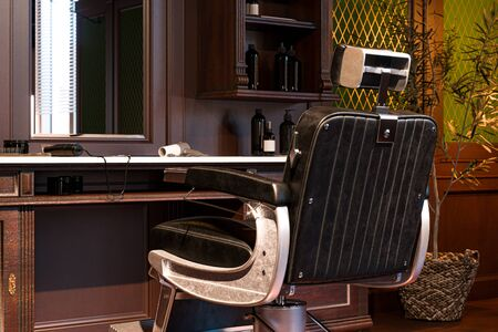 Vintage Interior Of Stylish Barber Shop. Retro Chair And Wooden Table With Trimmer And Fan. 3d Rendering 写真素材