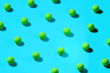 Green Baseball Balls Isolated On Blue Background. 3d Rendering