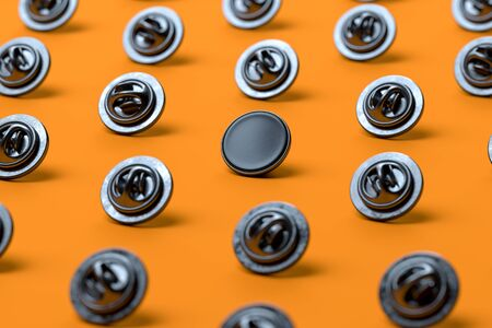 Black Blank Pin Buttons With Empty Space Isolated On Orange Background, 3d rendering.
