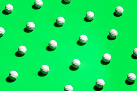 Golf Balls Isolated On green Background. Wallpaper. 3d Rendering