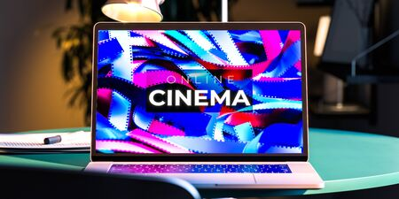 Modern Laptop With App For Online Movies Watching. The Cinema Inscription on Screen. 3d Rendering
