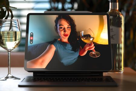 Woman Talking From Tablet By Video Chat To Her Friend And Drinking Wine. Online Date, Meeting With Friends. Stay Home. Social Distance. 3d rendering Reklamní fotografie