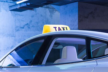 Yellow Taxi Car Roof Sign. Taxi At Underground Parking. 3d Rendering. Reklamní fotografie - 147109878