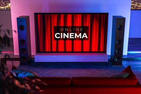 Sound Speakers and TV Set With App For Online Movies Watching. The Cinema Inscription On Theatre Red Velvet Curtains Background. 3d Rendering