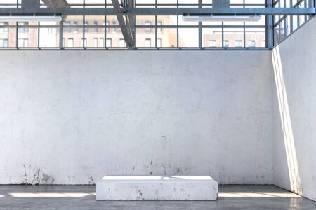 Concrete Showcase In Enlightened White Hangar, Empty Factory Interior or Warehouse With Concrete Floor. 3d rendering