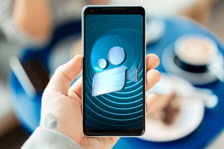 Close up of Man Hand Holding Modern Mobile Phone With App For Watching Online Movies. Film or Cinema Icon at Screen. 3d Rendering Reklamní fotografie - 147531089
