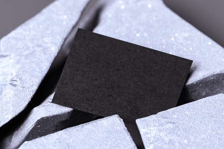 Close up of Black Blank Business Card On Broken Concrete Or Stone. Empty space. Copy space. 3d rendering. 版權商用圖片
