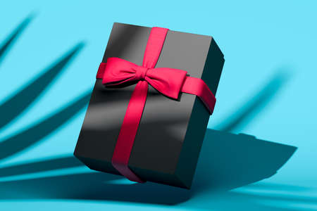 Blank gift box with bow for holidays, celebration and sale event concept. Present package template. Black gift box with pink ribbon bow on blue background. High quality 3d rendering