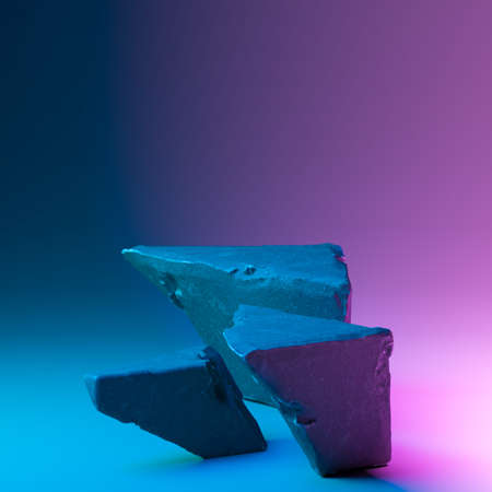 White stone podiums for branding and product presentation. Debris concrete showcases with colorful illuminated with neon light background. Copy space. Empty space. Realistic 3d rendering