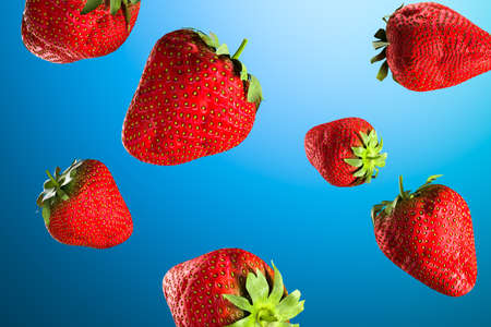 Juicy ripe strawberries on blue background. Natural organic food. Healthy lifestyle. High quality 3d illustration Banque d'images