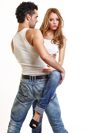 pareja sexy posando sobre fondo blanco Foto de archivo