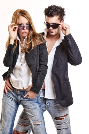sexy couple black background: fashion couple with sunglasses Stock Photo
