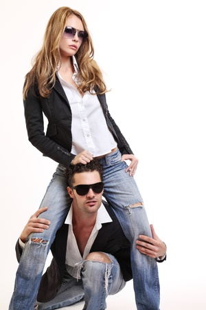 sexy funny: young fashion couple posing in studio