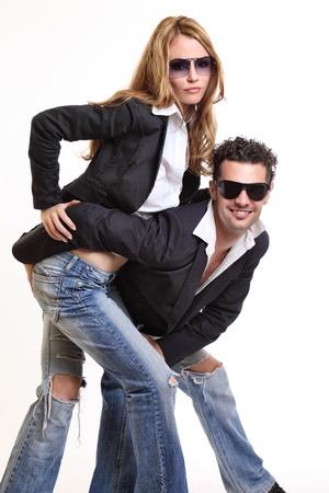 fashion couple posing in studio photo