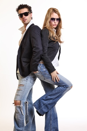 fashion couple posing in studio