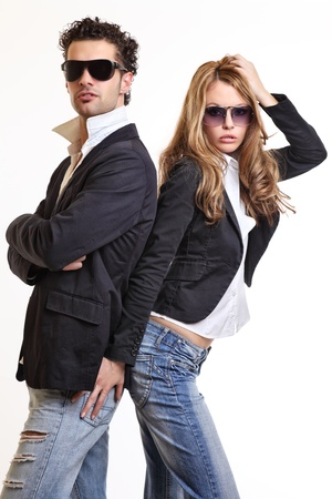 young sexy couple posing in studio photo